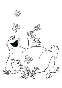 målarbok Cookie-monster spelar med fjärilar